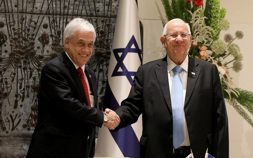 President Reuven Rivlin (R) and his Chilean counterpart Sebastian Pinera shake hands prior to their meeting at the President's Residence in Jerusalem on June 26, 2019. (Gali TIbbon/AFP).