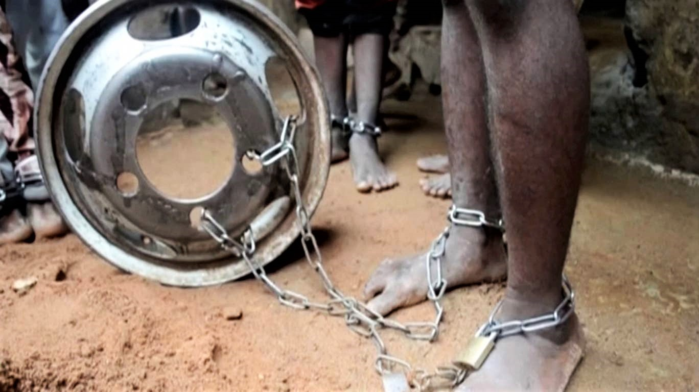 People are pictured with chained ankles and wrists. (Television Continental/via REUTERS)