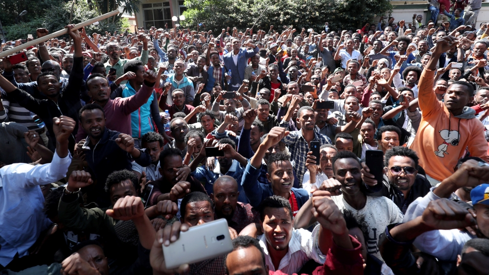 At least 400 young men joined the protest at Jawar's house in the capital Addis Ababa while some two dozen police officers stood nearby [Tiksa Negeri/Reuters]