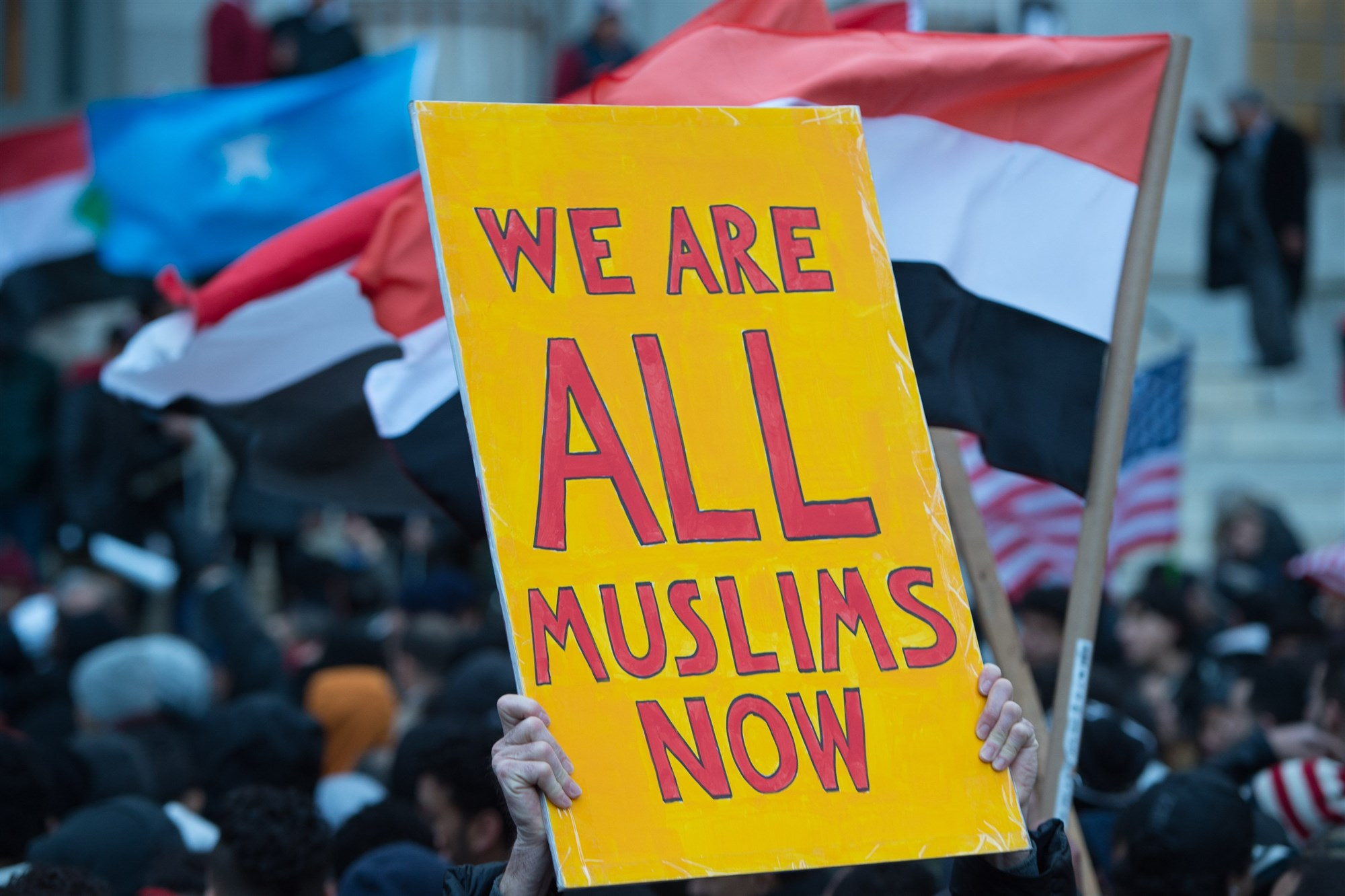 People rally at Brooklyn Borough Hall as Yemeni bodega and grocery-stores shut down to protest US President Donald Trump's Executive Order banning immigrants and refugees from seven Muslim-majority countries, including Yemen, on February 2, 2017 in New York. (Bryan R. Smith - AFP/Getty Images).