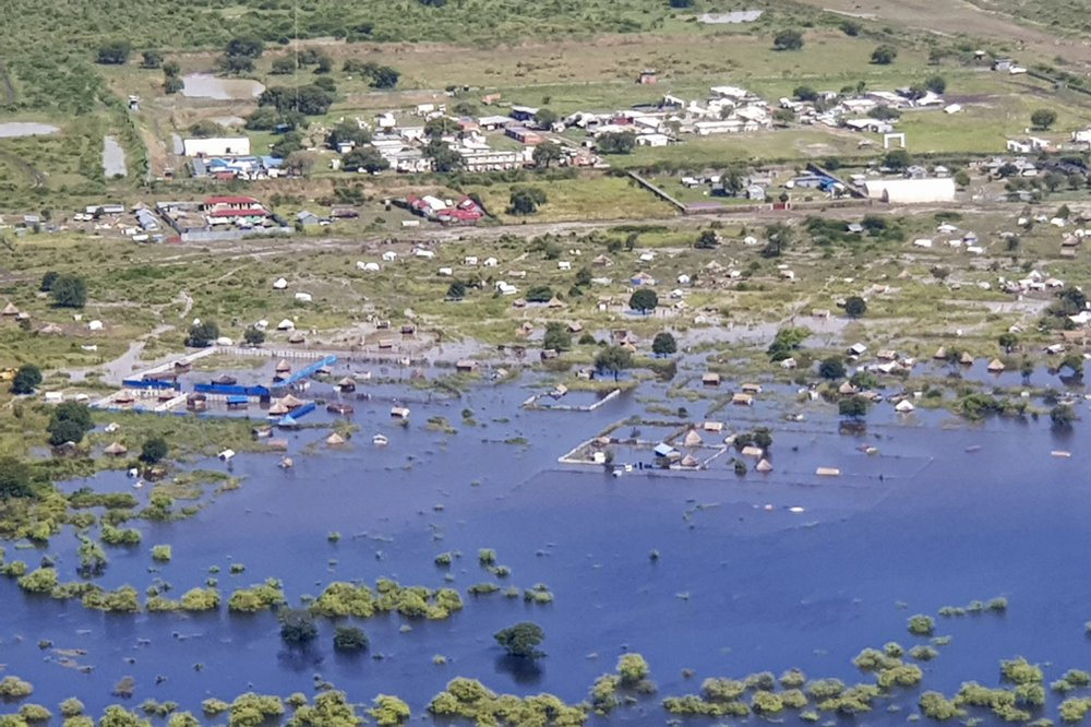 In this photo taken Sunday, Oct. 20, 2019 and released by Medecins Sans Frontieres, areas are submerged by floodwaters between Bor and Pibor, seen from the air, in South Sudan. South Sudan's president on Tuesday, Oct. 29, 2019 declared a state of emergency in 27 counties because of the flooding and parts of the East African region are bracing for a tropical storm that could worsen an already dire humanitarian situation. (Medecins Sans Frontieres via AP)
