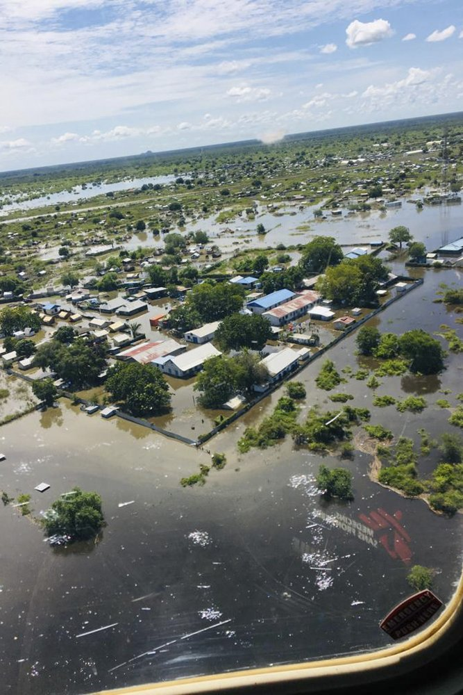 In this photo taken Thursday, Oct. 17, 2019 and released by Medecins Sans Frontieres, their primary healthcare centre is shown surrounded by floodwaters in Pibor, seen from the air, in South Sudan. South Sudan's president on Tuesday, Oct. 29, 2019 declared a state of emergency in 27 counties because of the flooding and parts of the East African region are bracing for a tropical storm that could worsen an already dire humanitarian situation. (Medecins Sans Frontieres via AP)