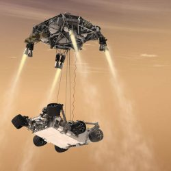 This artist's concept shows the sky-crane maneuver during the descent of NASA's Curiosity rover to the Martian surface. The Mars mission launching in 2020 would leverage the design of this landing system and other aspects of the Mars Science Laboratory architecture. (image NASA/JPL)
