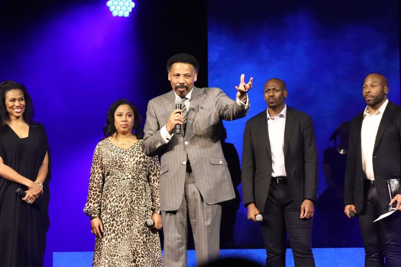 Pastor Tony Evans, center, speaks during the Kingdom Legacy Live event on Friday, Nov. 8, 2019, in Dallas. Evans' children stand behind him. (Image RNS by Adelle M. Banks)