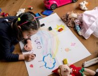 """A girls makes a drawing reading """"Everything is going to be alright"""", as part of school homework on the COVID-19 coronavirus on March 12, 2020 in Manta, near Cuneo, Northwestern Italy. (Images Marco Bertorello/AFP/GETTY Images)"""