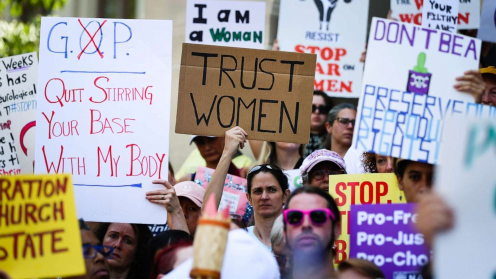 Women hold signs during a protest against recently passed abortion ban bills at the Georgia State Capitol building, in Atlanta, May 21, 2019 (Elijah Nouvelage/Getty Images)