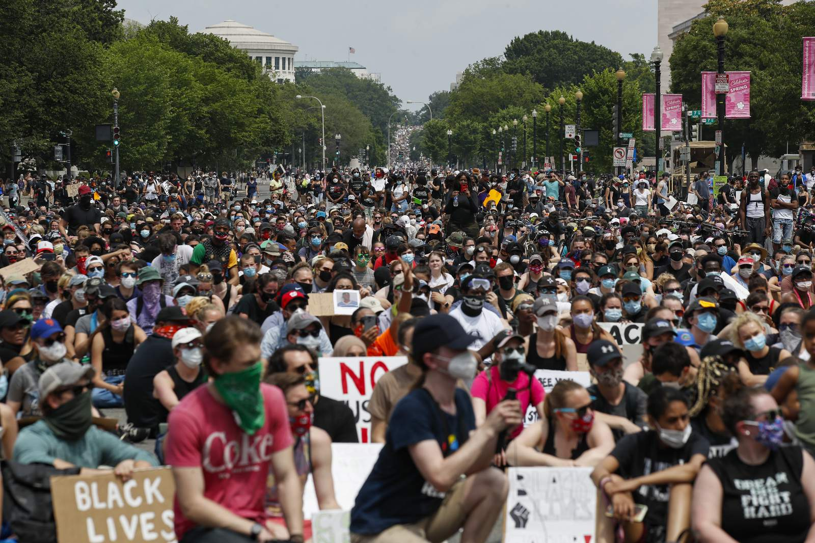 Demonstrators protest Saturday, June 6, 2020, in Washington, over the death of George Floyd, a black man who was in police custody in Minneapolis. Floyd died after being restrained by Minneapolis police officers. (Images AP/Alex Brandon)