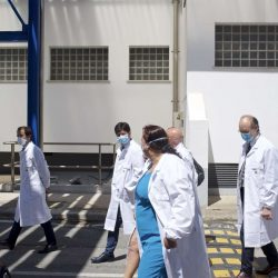 Roberto Speranza, Italian health minister, center facing camera, is taken on a tour of the labs at IRBM in Pomezia, Italy, on June 18, 2020. (Geraldine Hope Ghelli)