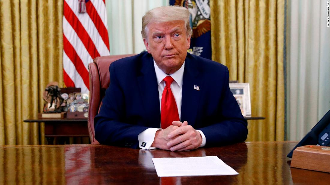 President Donald Trump participates in a law enforcement briefing on the MS-13 gang in the Oval Office of the White House, Wednesday, July 15, 2020, in Washington. (AP Photo/Patrick Semansky)