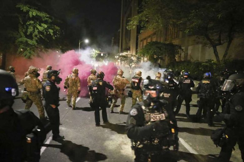 Oregon sues feds over Portland protests as unrest continues. Militarized federal agents deployed by the president to Portland, fired tear gas against protesters again overnight (Image by Dave Killen:AP)