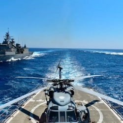 In this photo provided by the Greek Defense Ministry, warships take part in a military exercise in the eastern Mediterranean sea on Aug. 25. (Greek Defense Ministry/AP)