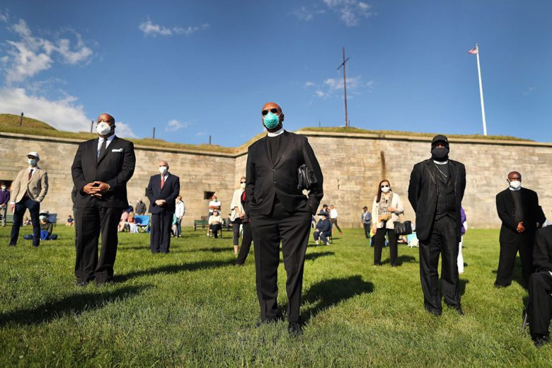 Black clergy members stand with other attendees during a Mass for racial healing on Castle Island in South Boston on June 13, 2020 (Getty/John Tlumacki/The Boston Globe)
