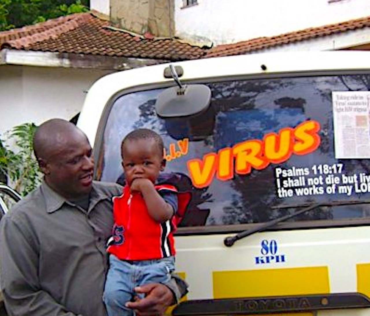 """A FORUM member """"living positively with AIDS,"""" pictured with his son. He uses his matatu (taxi) to send messages to the community about positive living and preventing HIV/AIDS."""