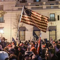 Supporters of President Donald Trump wave a Betsy Ross flag with a circle of 13 five-point stars representing the 13 original colonies flies during a protest Dec. 12 in Washington (© Stephanie Keith/Getty Images)